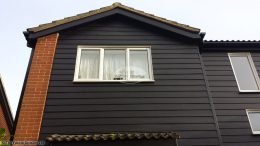 Hardieplank cladding with UPVC Black ash fascias and soffits