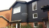 Black ash fascias and soffits with Black Hardieplank cladding