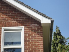 New fascias with white flat soffit and grey guttering installation Headington, Oxford