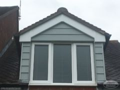 Hardieplank cladding around dormer window