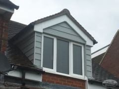 Hardieplank cladding around dormer window in Oxford