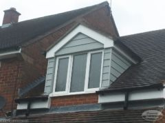 PVC fascias and guttering with Hardieplank cladding