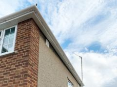 white round guttering with white fascia and soffit